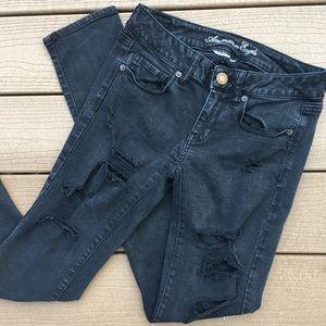 AE Super Stretch Skinny Black Distressed Jeans 4
